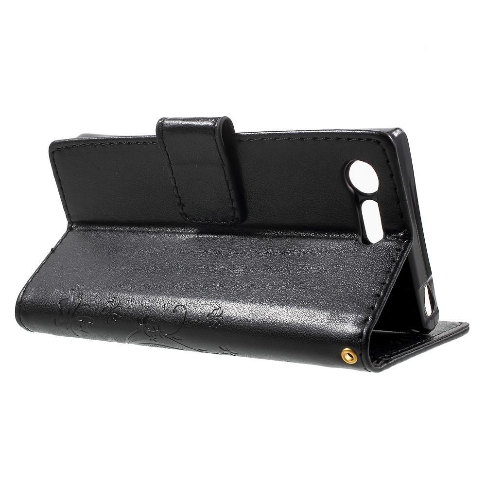 Läderfodral Fjärilar Sony Xperia X Compact svart